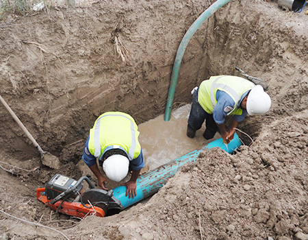 workers installing sewer line